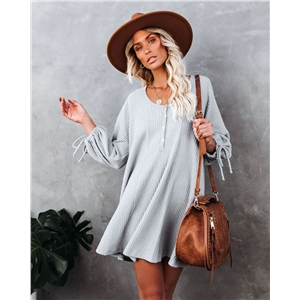 Women's solid color knitted long-sleeved big swing lace-up cuff dress